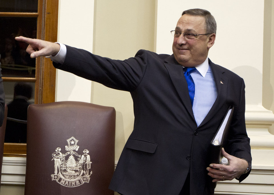 Gov. Paul LePage acknowledges applause before delivering his State of the State address to a joint session of the Legislature, Tuesday, Feb. 5, 2013, at the State House in Augusta, Maine. (AP Photo/Robert F. Bukaty)