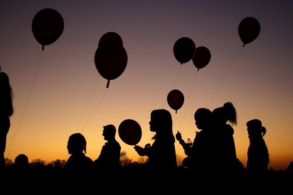 A crowd carries balloons as they participate in the Leukemia and Lymphoma Society\'s Light the Night Walk at Lake Hefner in Oklahoma City, SUnday, Oct. 23, 2011. Photo by Bryan Terry, The Oklahoman