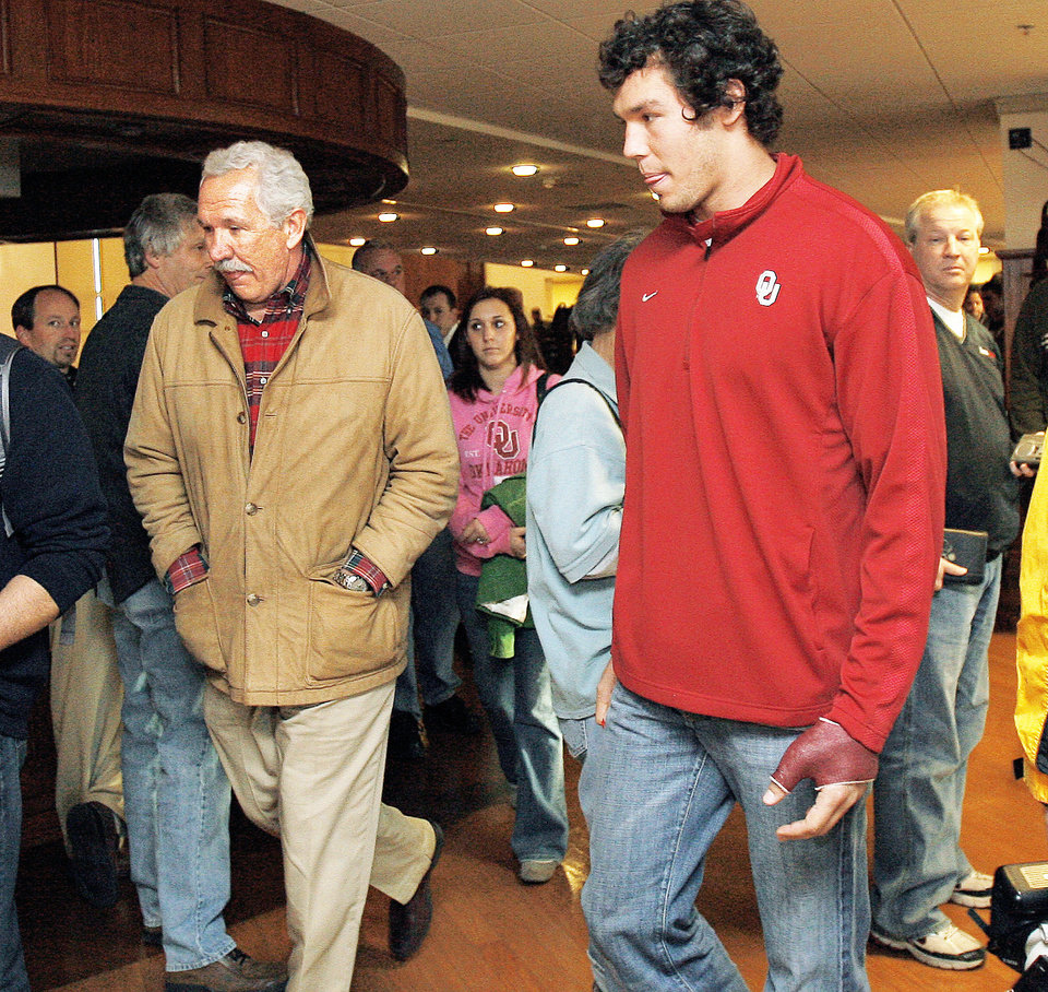 Kent, left, and Sam Bradford leave Wednesday's press conference after Sam Bradford announced his decision to stay at Oklahoma.  Photo by sarah Phipps, the oklahoman