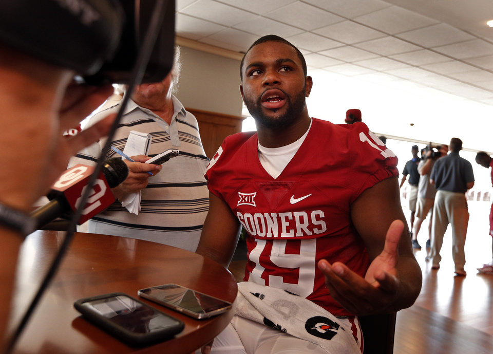Photo -  Eric Striker speaks to the media at a press conference following Meet the Sooners Day activities for the University of Oklahoma Sooners (OU) football team at Gaylord Family-Oklahoma Memorial Stadium in Norman, Okla., on Saturday, Aug. 8, 2015. Photo by Steve Sisney, The Oklahoman