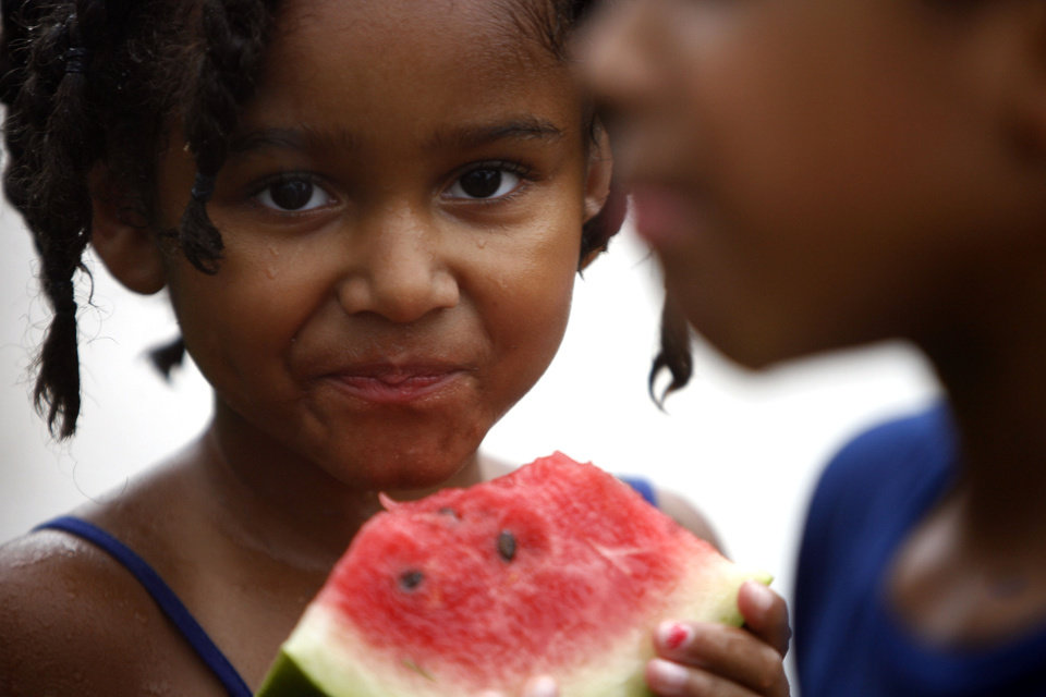 Uriah Smith, 5, eats watermelon during the LibertyFest's ParkFest at the University of Central Oklahoma, Sunday, July 4, 2010, in Edmond, Okla. Photo by Sarah Phipps, The Oklahoman