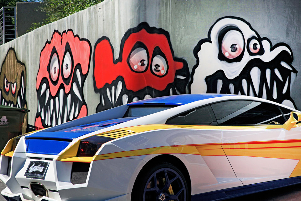Photo - This Sunday May 12, 2013 photo shows a mural painted on the outside of musician Chris Brown's home in Los Angeles. The Grammy-winning musician's neighbors are unhappy with what some are calling frightening art he's chosen to have painted along the curb of his Hollywood Hills home. (AP Photo/Richard Vogel)