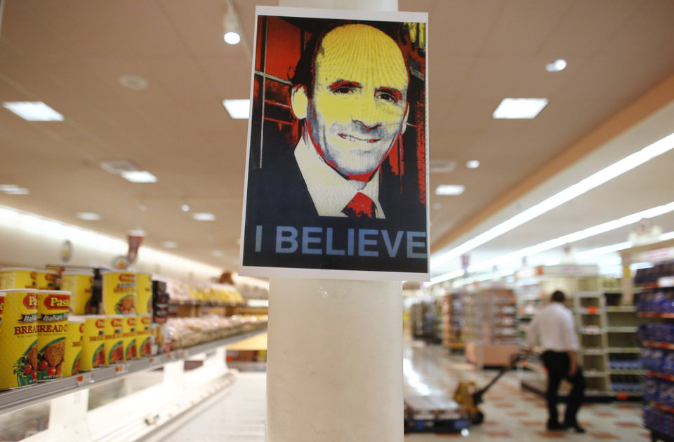 Photo - A likeness of former Market Basket CEO Arthur T. Demoulas is attached to a post at a Market Basket supermarket location, Thursday, Aug. 28, 2014, in Chelsea, Mass. A six-week standoff between thousands of employees of the New England supermarket chain and management has ended with the news that the beloved Demoulas is back in control after buying the entire company. (AP Photo/Steven Senne)