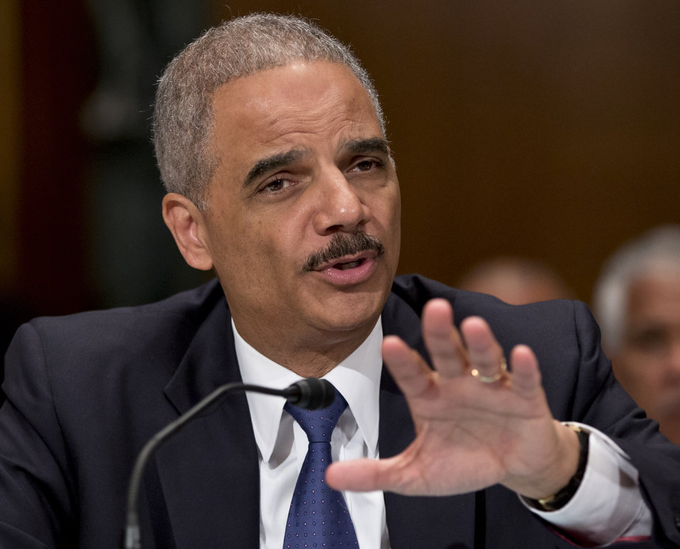 Photo - FILE - In this June 6, 2013, file photo, Attorney General Eric Holder testifies on Capitol Hill in Washington, Thursday, June 6, 2013.  The U.S. government's aggressive prosecution of leaks and efforts to control information are having a chilling effect on journalists and government whistle-blowers, according to a report released Thursday, Oct. 10, 2013, on U.S. press freedoms under the Obama administration. (AP Photo/J. Scott Applewhite, File)