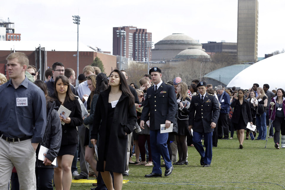People arrive to a memorial service for fallen Massachusetts Institute of Technology campus officer Sean Collier at MIT in Cambridge, Mass. Wednesday, April 24, 2013. Authorities say Collier was killed by the Boston Marathon bombing suspects last Thursday, April 18. He had worked for the department a little more than a year.  Vice President Joe Biden, MIT President L. Rafael Reif, police chief John DiFava and members of Collier's family are scheduled to speak. (AP Photo/Elise Amendola)
