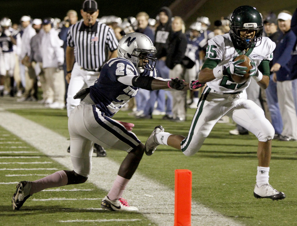 Edmond Santa Fe's Dale Jefferson is pushed out by Edmond North's Christian Peterson during a high school football game at Wantland Stadium in Edmond, Okla., Friday, Oct. 29, 2010.  Photo by Bryan Terry, The Oklahoman