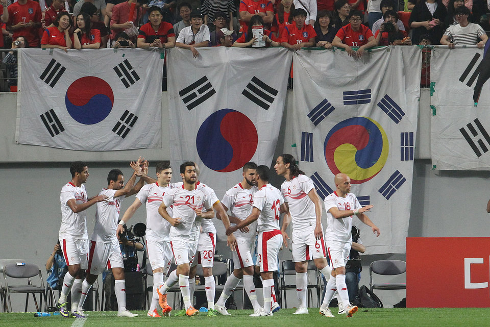 Photo - Tunisia's Zouhaier Dhaouadi, second from left, celebrates with his teammates after scoring a goal during a friendly soccer match against South Korea at World Cup stadium in Seoul, South Korea, Wednesday, May 28, 2014. South Korea will play against Belgium, Russia and Algeria in Group H of the World Cup 2014 in Brazil. (AP Photo/Ahn Young-joon)
