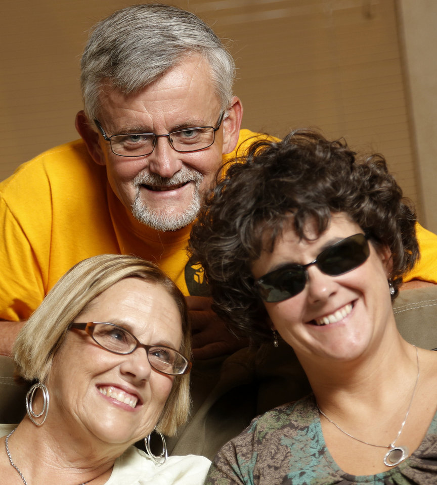 Photo - Gary Farnum and his wife, Glenda, left, and daughter, Audrey, at their home in Oklahoma City. Photo by Doug Hoke, The Oklahoman