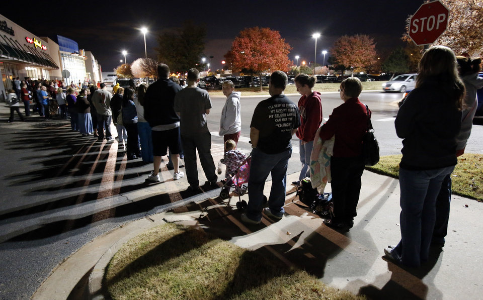 Patrons line up at Toys R Us as they open at 8:00 p.m. on Thanksgiving Day for pre-Black Friday Sales on Thursday, Nov. 22, 2012, in Norman, Okla. Photo by Steve Sisney, The Oklahoman