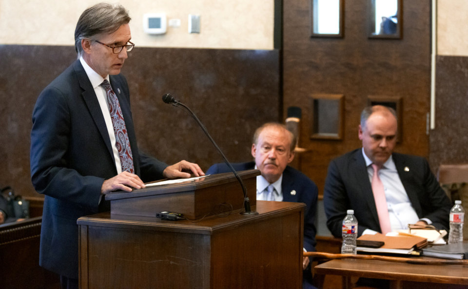 Photo - Attorney General Mike Hunter speaks during the hearing to settle the Journal Entry of Judgment for opioid trial at the Cleveland County Courthouse in Norman, Okla. on Tuesday, Oct. 15, 2019. Judge Balkman ruled last Aug. in favor of the State of Oklahoma, for Johnson and Johnson pay $572 million to a plan to abate the opioid crisis.  [Chris Landsberger/The Oklahoman]