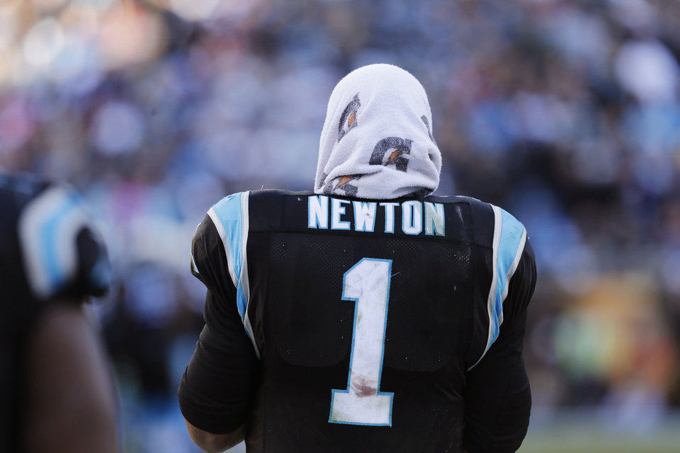 Photo - Carolina Panthers quarterback Cam Newton (1) stands on the sideline during the second half of a divisional playoff NFL football game against the San Francisco 49ers, Sunday, Jan. 12, 2014, in Charlotte, N.C. (AP Photo/Chuck Burton)