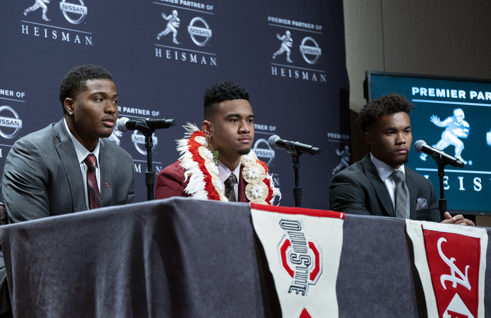 Photo - Heisman Trophy finalists, from left, Dwayne Haskins, from Ohio State; Tua Tagovailoa, from Alabama; and Kyler Murray, from Oklahoma, answer questions during a media event Saturday, Dec. 8, 2018, in New York. (AP Photo/Craig Ruttle)