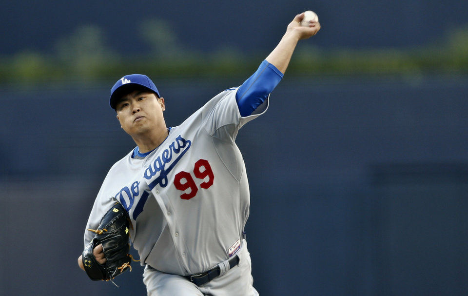 Los Angeles Dodgers starting pitcher Hyun-Jin Ryu works against the San Diego Padres in the first inning of the opening game of Major League baseball in the United States, Sunday, March 30, 2014, in San Diego. (AP Photo/Lenny Ignelzi)