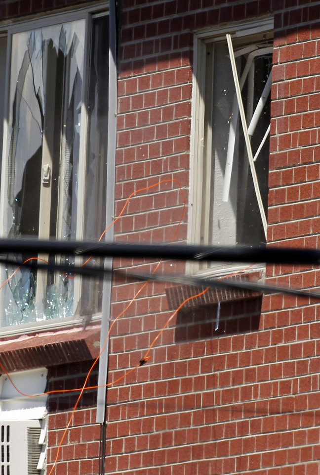 Photo -   Debris and cords fall out of a window as a