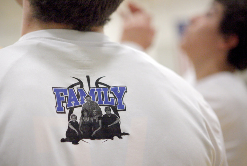 A picture of the Budke family is seen on the back of Stillwater's warm-up jerseys before a high school basketball game at Bishop McGuinness in Oklahoma City, Tuesday, Jan. 10, 2012. Photo by Bryan Terry, The Oklahoman
