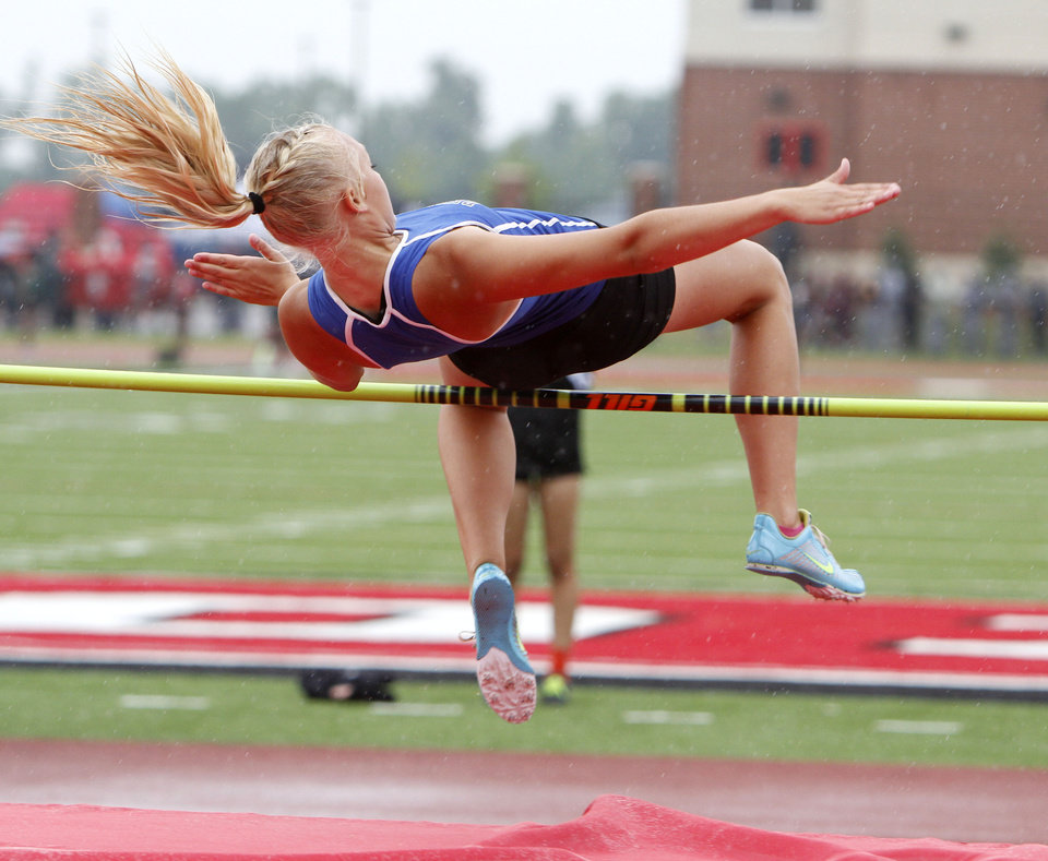 Photo - CLASS 5A / CLASS 6A / HIGH SCHOOL TRACK AND FIELD / STATE TOURNAMENT: Deer Creek's Jessie Heiden clears the bar in the high jump event during the 5A and 6A state finals track meet at Yukon High School in Yukon, OK, Friday, May 11, 2012,  By Paul Hellstern, The Oklahoman