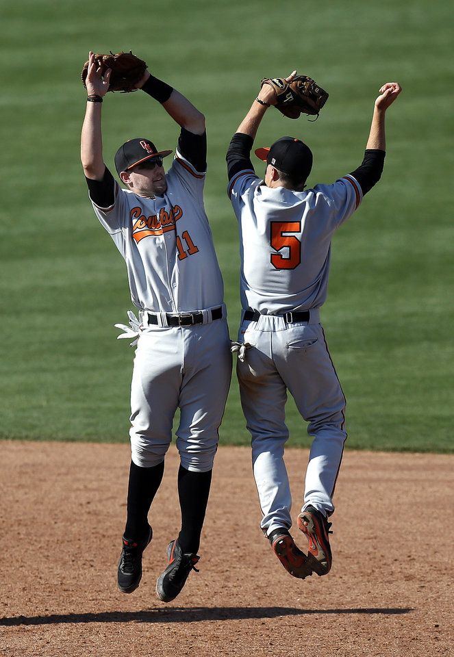 Photo - Oklahoma State's Robbie Rea (11) and Donnie Walton celebrate following the Bedlam baseball game between the University of Oklahoma and Oklahoma State University at the Chickasaw Bricktown Ballpark in Oklahoma CIty, Saturday, May 11, 2013. Photo by Sarah Phipps, The Oklahoman