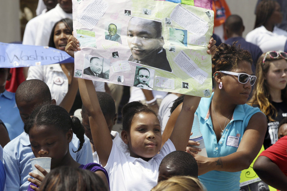 Nyla Washington, 10, of Little Rock, Ark., holds a poster she made showing Rev. Martin Luther King at the Arkansas state Capitol in Little Rock, Ark., Wednesday, Aug. 28, 2013. Hundreds gathered at the Capitol to mark the 50th anniversary of the March on Washington. (AP Photo/Danny Johnston)
