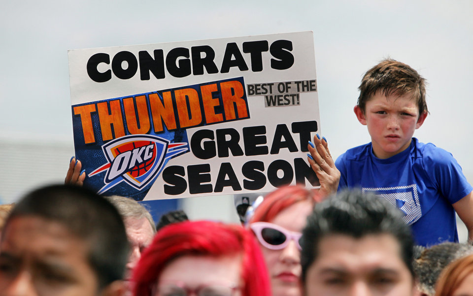 Photo - Thunder fans wait for the teams arrival in high temperatures at a welcome home rally for the Oklahoma City Thunder in a field at Will Rogers World Airport after the team's loss to the Miami Heat in the NBA Finals, Friday, June 22, 2012. Photo by Nate Billings, The Oklahoman