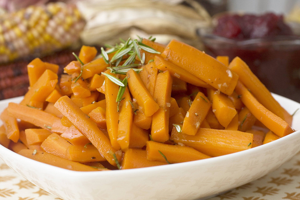 Photo - Maple whiskey glazed carrots .    AP Photo/Larry Crowe  Larry Crowe - AP