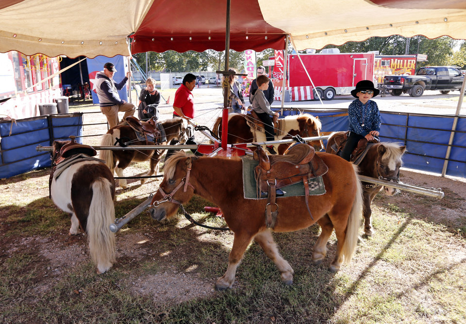 Photo -  Children ride ponies at the Kelly Miller Circus. [PHOTO BY STEVE SISNEY, THE OKLAHOMAN]