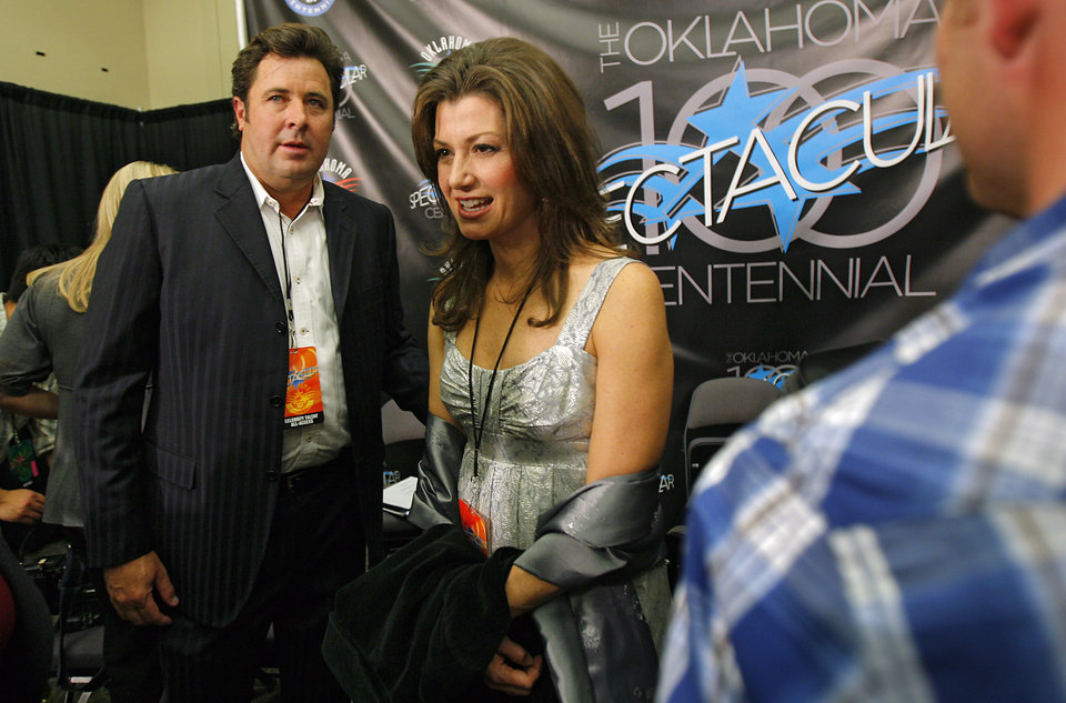 Photo - Vince Gill and Amy Grant leave the press conference during the Centennial Spectacular to celebrate the 100th birthday of the State of Oklahoma at the Ford Center on Friday, Nov. 16, 2007, in Oklahoma City, Okla. Photo By CHRIS LANDSBERGER, The Oklahoman
