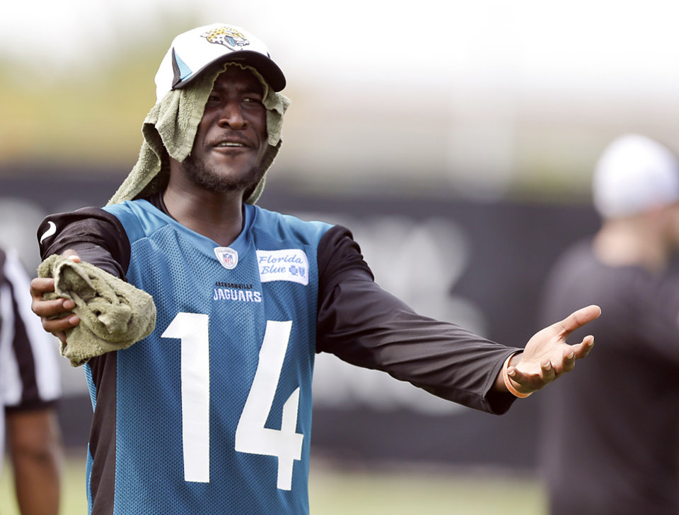 Jacksonville Jaguars wide receiver Justin Blackmon gestures to an official after a touchdown by the offensive unit was nullified during NFL football training camp, Saturday, July 27, 2013, in Jacksonville, Fla. Blackmon, in his second year out of Oklahoma State, will sit out the first four games of the NFL season. (AP Photo/John Raoux)