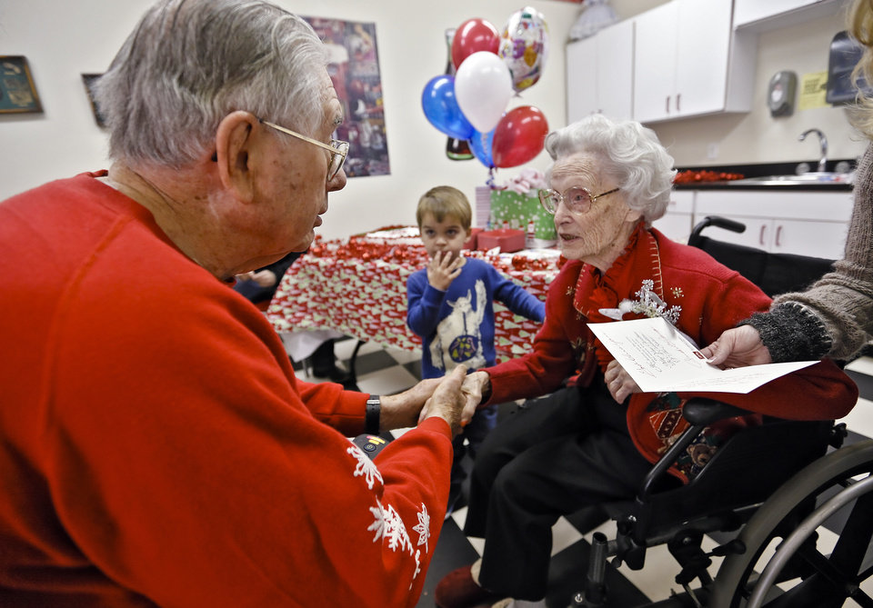 Ora E. Holland talks to Claude Pittenger during Holland's early birthday celebration at Heritage Assisted Living Center on Saturday, Dec. 22, 2012, in Oklahoma City, Okla. Holland will celebrate her 112th birthday on Dec. 24, 2012.   Photo by Chris Landsberger, The Oklahoman
