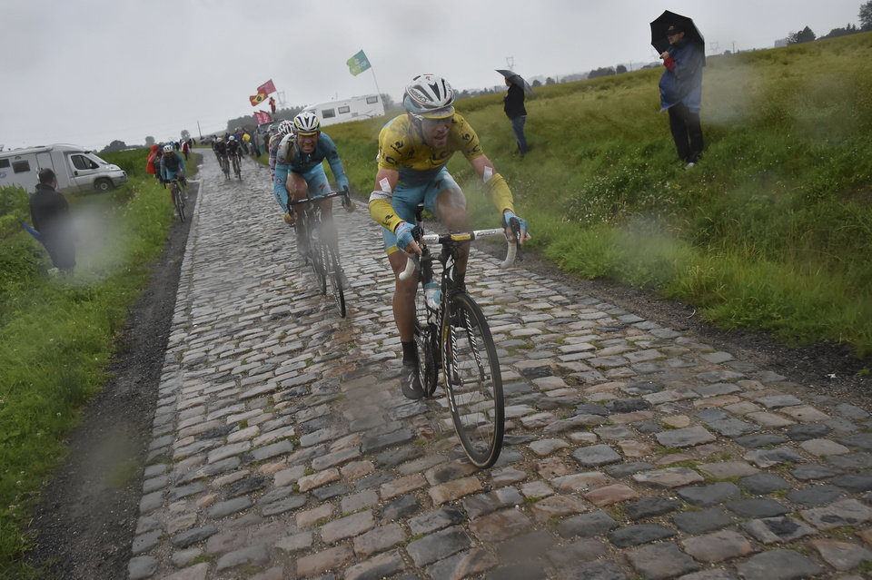 Photo - Italy's Vincenzo Nibali, wearing the overall leader's yellow jersey, and Denmark's Jakob Fuglsang, in second position, ride during the fifth stage of the Tour de France cycling race over 155 kilometers (96.3 miles) with start in Ypres, Belgium, and finish in Arenberg, France, Wednesday, July 9, 2014. (AP Photo/Bernard Papon, Pool)