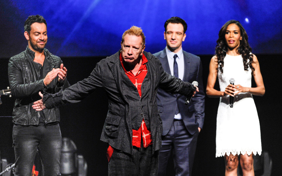 Photo - Singer John Rotten Lydon, center, steals the show as Ben Forster, left, JC Chasez and Michelle Williams look on at the