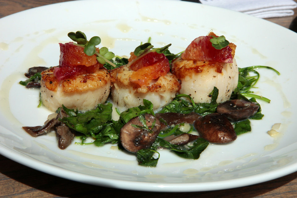 Photo - Scallops are a common sight on the specials menu at Packard's New American Kitchen.  David McDaniel - The Oklahoman