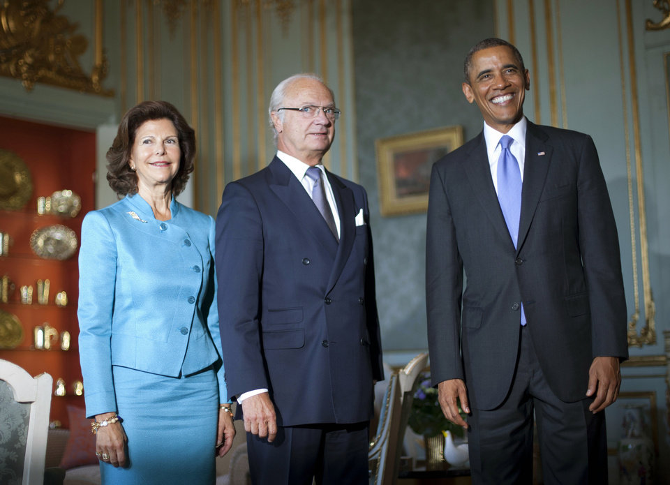 Photo - U.S. President Barack Obama, right, meets with Swedish King Carl XVI Gustaf, center, and Queen Silvia at the Royal Palace, Thursday, Sept. 5, 2013, in Stockholm, Sweden. (AP Photo/Pablo Martinez Monsivais)