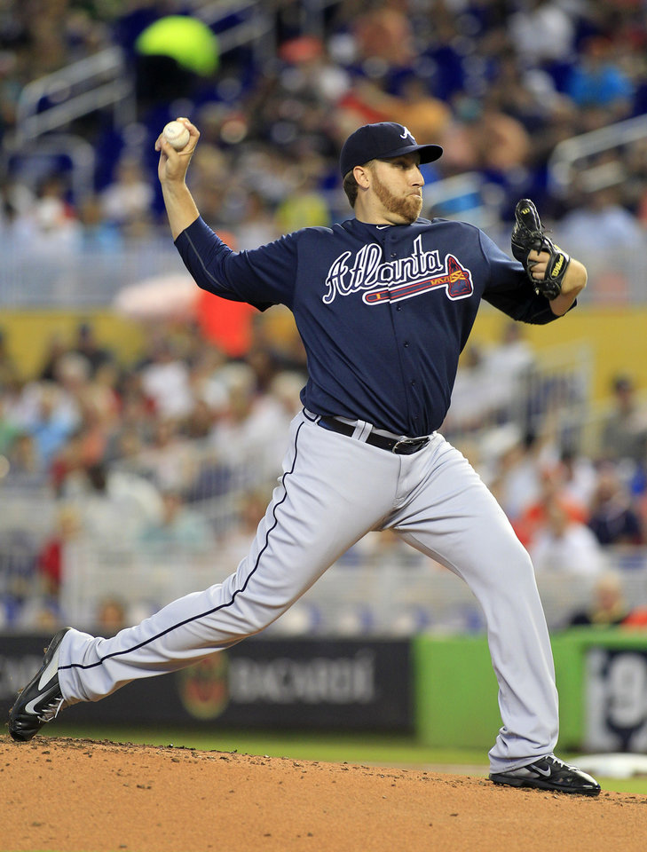 Photo - Atlanta Braves starting pitcher Aaron Harang throws against the Miami Marlins in the first inning during their baseball game in Miami, Sunday, June 1, 2014. (AP Photo/Joe Skipper)