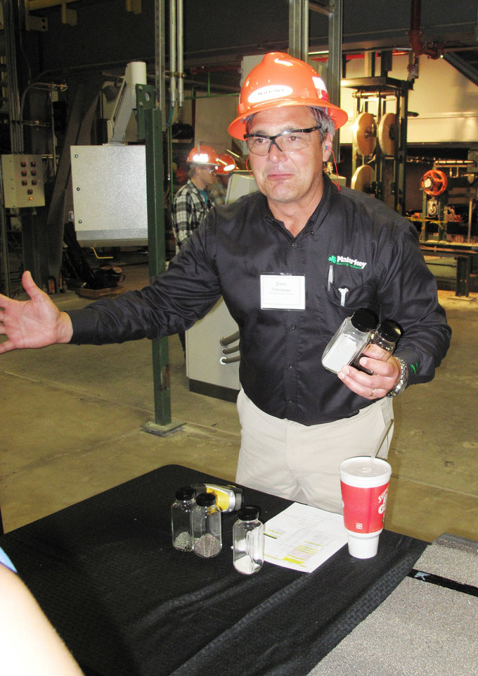 John Stromme, vice president of manufacturing, tells a tour group about the raw materials that go into products made by Malarkey Roofing Products at the plant's grand opening Thursday. <strong>Richard Mize - The Oklahoman</strong>