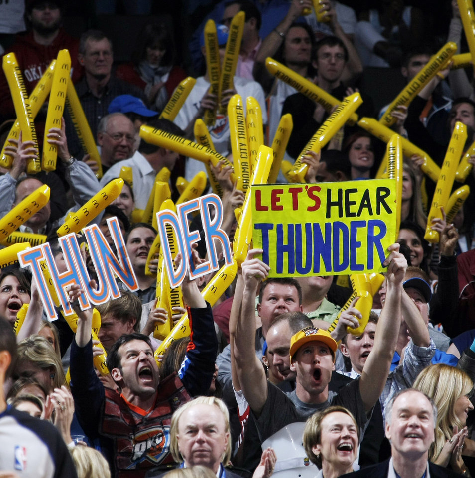 Photo - Thunder fans cheer during the NBA basketball game between the Washington Wizards and the Oklahoma City Thunder at the Oklahoma City Arena in Oklahoma City, Friday, January 28, 2011. The Thunder won, 124-117, in double overtime. Photo by Nate Billings, The Oklahoman