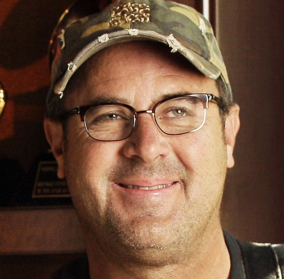 Photo - In this Aug. 16, 2011 photo, Vince Gill, who was born in Norman and raised in Oklahoma City, is shown with some of his Grammy awards at his home in Nashville, Tenn. (AP Photo/Mark Humphrey)  Mark Humphrey - AP