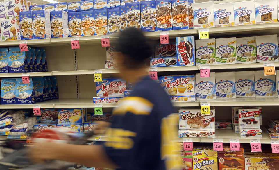 A customer walks past Hostess products at Crest in Edmond, Okla.,  Friday, Nov. 16, 2012. Photo by Sarah Phipps, The Oklahoman