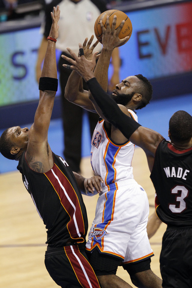 Oklahoma City's James Harden (13) shoots over Miami's Chris Bosh (1) and Dwyane Wade (3) during Game 2 of the NBA Finals between the Oklahoma City Thunder and the Miami Heat at Chesapeake Energy Arena in Oklahoma City, Thursday, June 14, 2012. Photo by Chris Landsberger, The Oklahoman