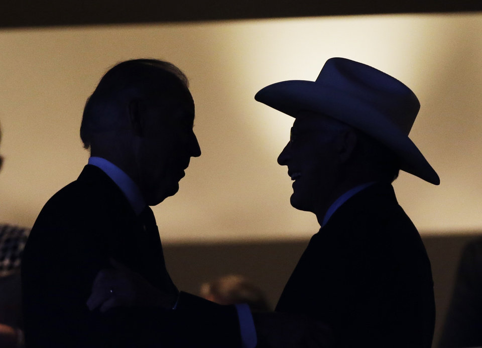 Photo - Vice President Joe Biden speaks Secretary of the Interior Ken Salazar during the Democratic National Convention in Charlotte, N.C., on Tuesday, Sept. 4, 2012. (AP Photo/Charlie Neibergall)  ORG XMIT: DNC483