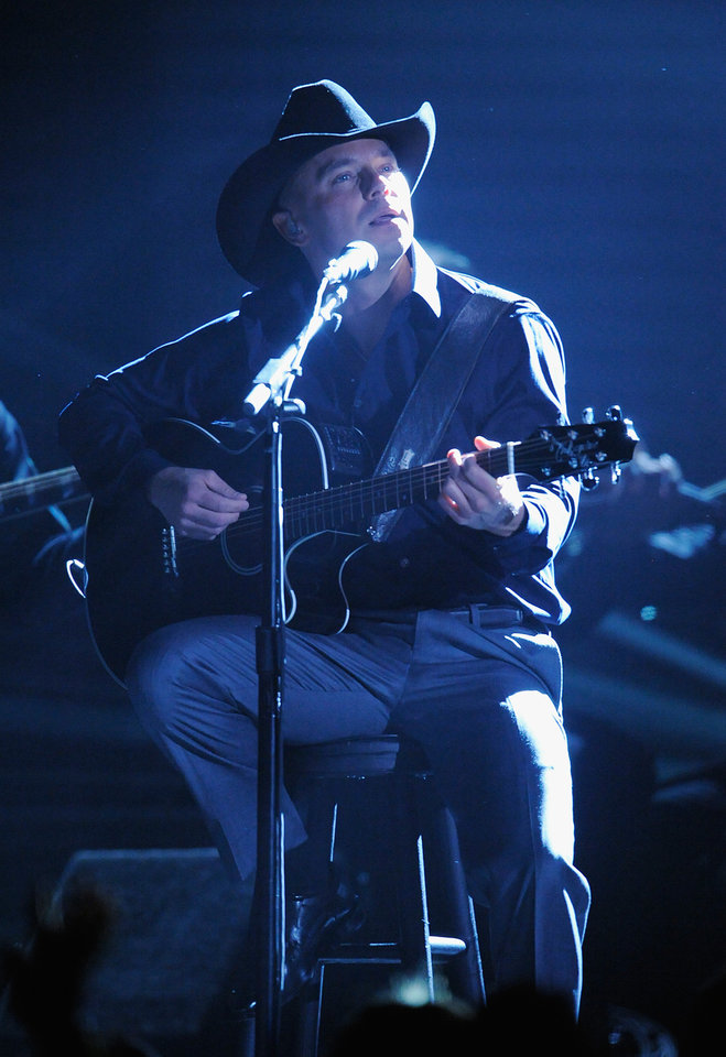 Photo - Kenny Chesney performs at the 51st Annual Grammy Awards on Sunday, Feb. 8, 2009, in Los Angeles. (AP Photo/Mark J. Terrill)