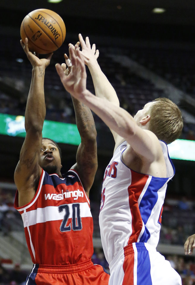 CORRECT DATE -Washington Wizards forward Cartier Martin (20) takes a shot against Detroit Pistons forward Kyle Singler (25) in the first half of an NBA basketball game in Auburn Hills, Mich., Friday, Dec. 21, 2012. (AP Photo/Duane Burleson)