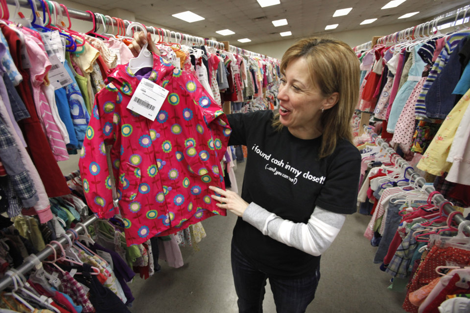 Kathy Winslow with Just Between Friends looks at items in her consignment sale at the Cleveland County Fairgrounds on Tuesday, Feb. 21, 2012, in Norman, Okla. Photo by Steve Sisney, The Oklahoman
