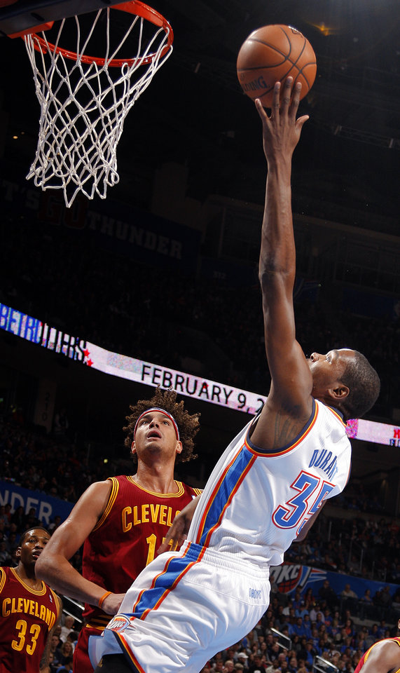 Photo - Oklahoma City's Kevin Durant (35) shoots over Cleveland's Anderson Varejao (17) during the NBA basketball game between the Oklahoma City Thunder and the Cleveland Cavaliers at the Chesapeake Energy Arena, Sunday, Nov. 11, 2012. Photo by Sarah Phipps, The Oklahoman