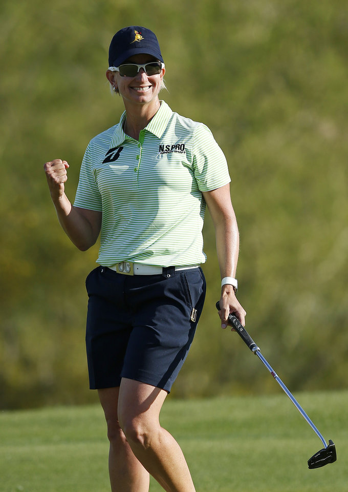 Photo - Karrie Webb, of Australia, smiles as she pumps her fist after making birdie on the 18th hole during the final round of the LPGA Founders Cup golf tournament on Sunday, March 23, 2014, in Phoenix. (AP Photo/Ross D. Franklin)