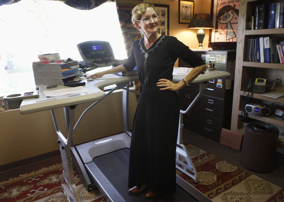 Photo -  Edmond physician Susan Dimick calls her office with it's standing treadmill desk her favorite place in her practice in Edmond. Photo by KT King, The Oklahoman   KT King -  The Oklahoman