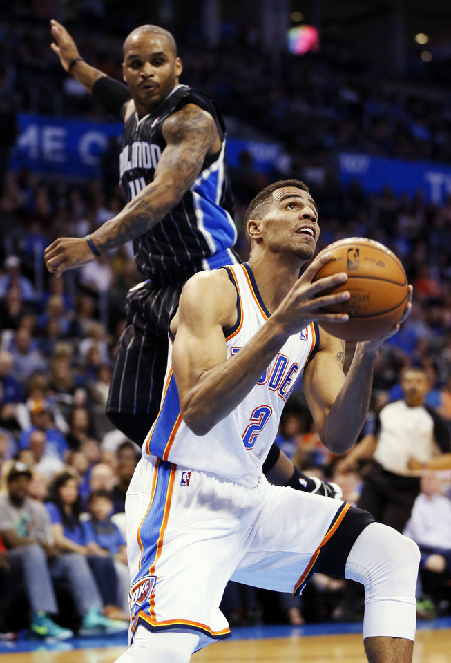 Oklahoma City's Thabo Sefolosha (2) works in front of Orlando's Jameer Nelson (14) during an NBA basketball game between the Oklahoma City Thunder and the Orlando Magic at Chesapeake Energy Arena in Oklahoma City, Friday, March 15, 2013. Photo by Nate Billings, The Oklahoman