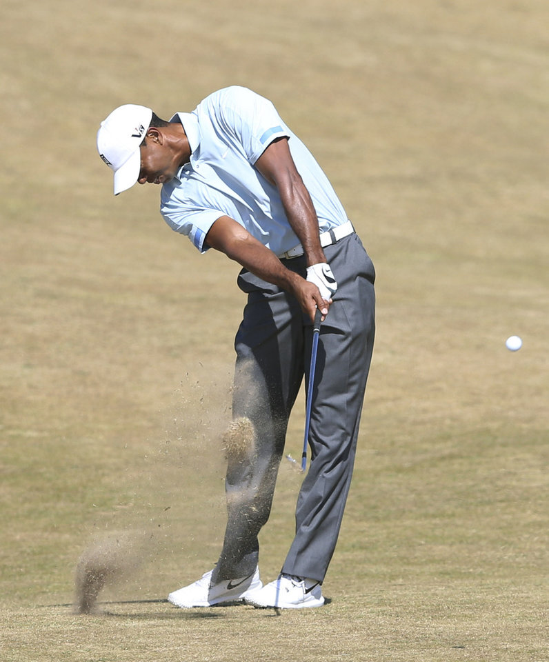 Photo - Tiger Woods of the United States plays a shot on the 6th fairway during the second round of the British Open Golf Championship at Muirfield, Scotland, Friday July 19, 2013. (AP Photo/Scott Heppell)