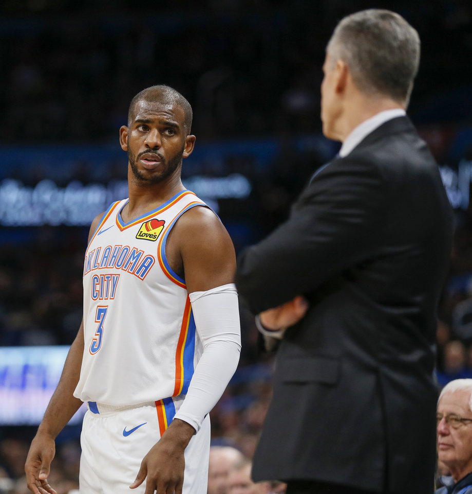 Photo - Oklahoma City's Chris Paul (3) listens to coach Billy Donovan during an NBA basketball game between the Indiana Pacers and the Oklahoma City Thunder at Chesapeake Energy Arena in Oklahoma City, Wednesday, Dec. 4, 2019. [Nate Billings/The Oklahoman]