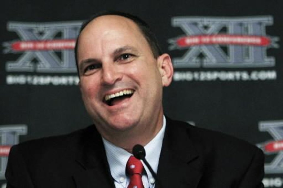 Photo - Oklahoma athletic director Joe  Castiglione talks with reporters during the Big 12 meetings Thursday, June 3, 2010, in Kansas City, Mo. (AP Photo/Orlin Wagner)