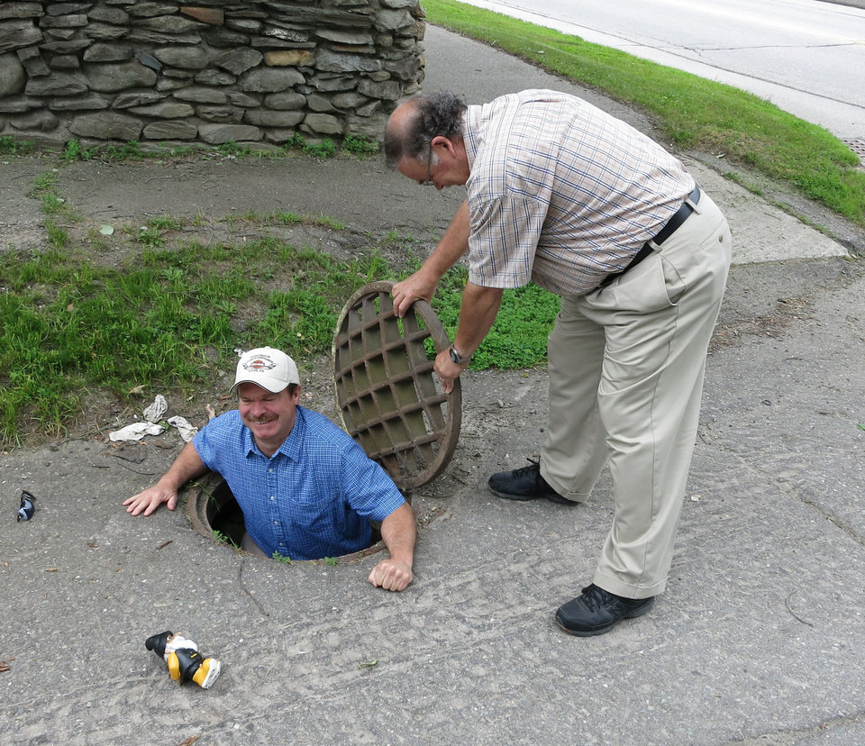 Photo -  Stu Tinker assists a visitor from Cincinnati, Dave, as he emerges from the